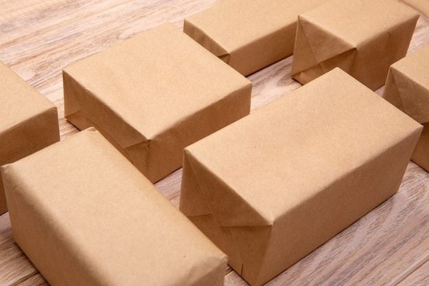 A lot of cardboard box on white wooden background. top view.