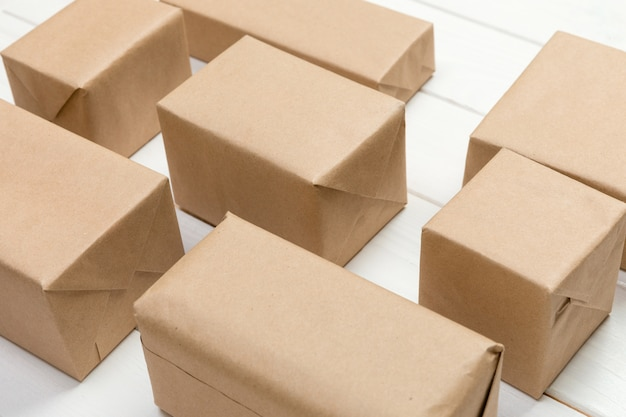 A lot of cardboard box on white wooden background. top view