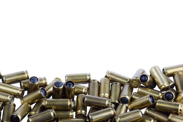 A lot of cartridges for a traumatic gun on a white background at the bottom of the photo