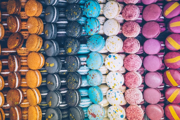 A lot of colorful macaroons on the candy shop.