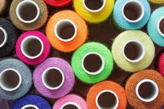 A lot of colorful sewing threads. abstract background