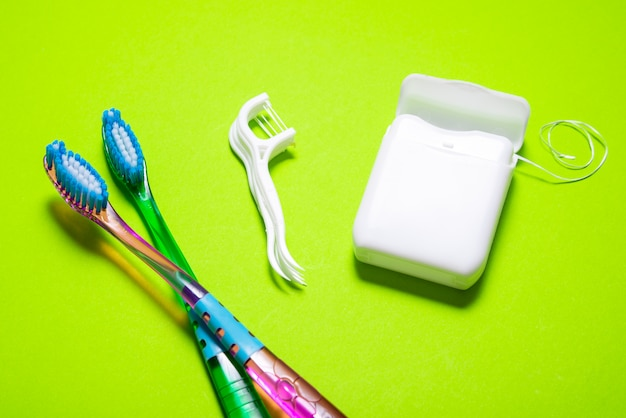 Lot of dental floss, toothbrush, toothpick