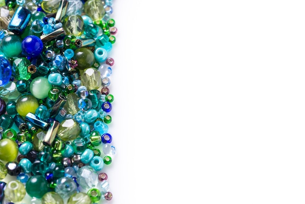 Lot of different glass beads, seed beads on white background