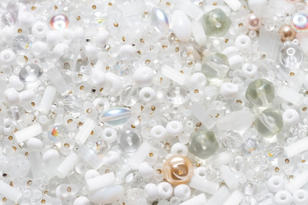 Lot of different glass beads and seedbeads, textured background