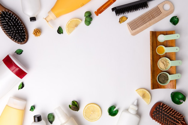 A lot of different natural cosmetic products for hair care on white table.