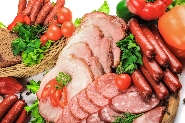 Lot of different sausages isolated on white