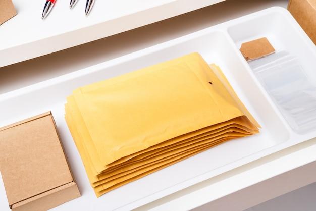 Lot of envelopes, boxes, zip locks in desk driwer