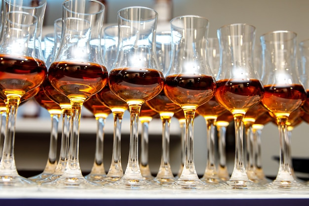 A lot of glasses with cognac.