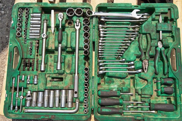 A lot of old instruments in tool box.