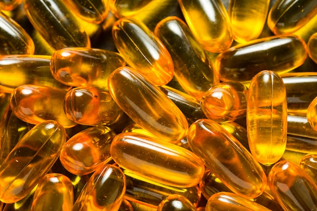 Lot of omega 3 capsules, background textures