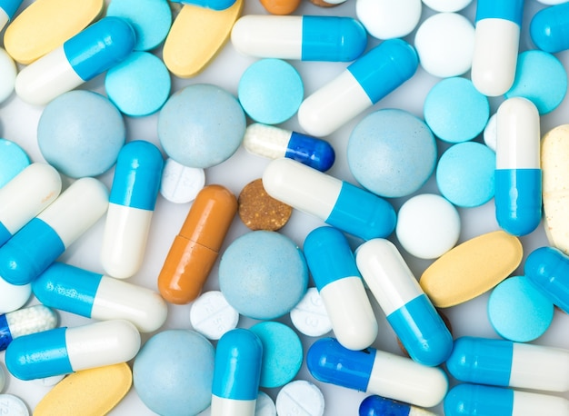 Lot of pills as background, close-up view