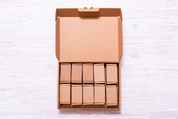 Lot of small cardboard boxes inside of large case with cover