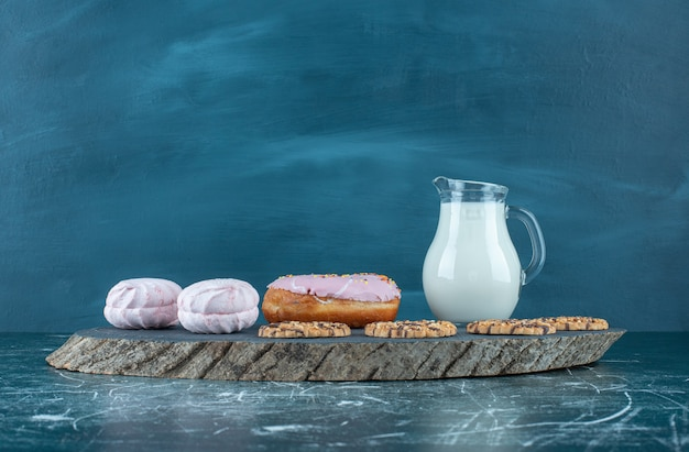 A lot of sweet confectionery with milk on a dark board. high quality photo