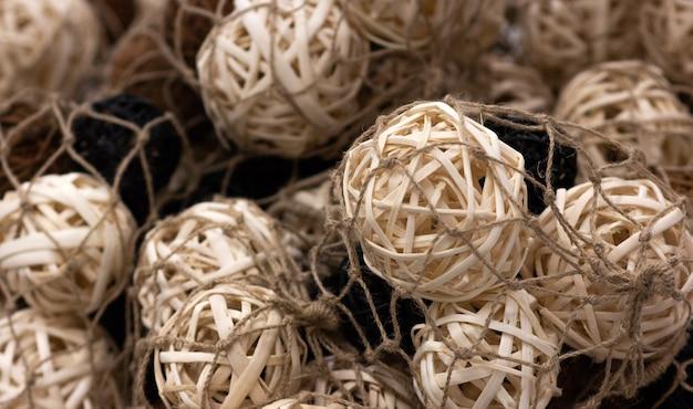 A lot wooden natural interior decorative wicker balls, close-up