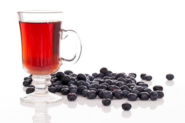 Lots of blueberries and a glass of tea