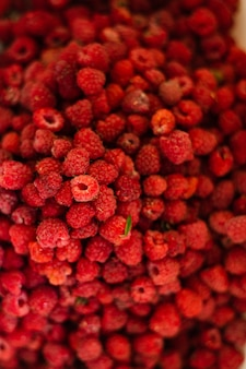 Lots of bright raspberries. background, picture for postcard