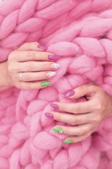 Lots of color gloss manicure hands has different blotches in pink