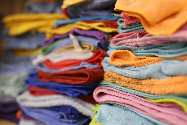 Lots of colorful microfiber cloths on shelf in service center microfiber cloths for household