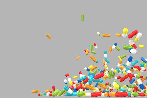 Lots of crumbling and falling colored pills on gray background.