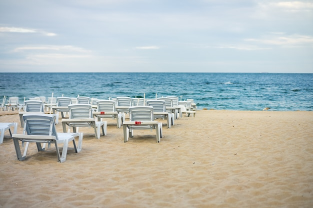 Lots of empty chairs on a deserted beach