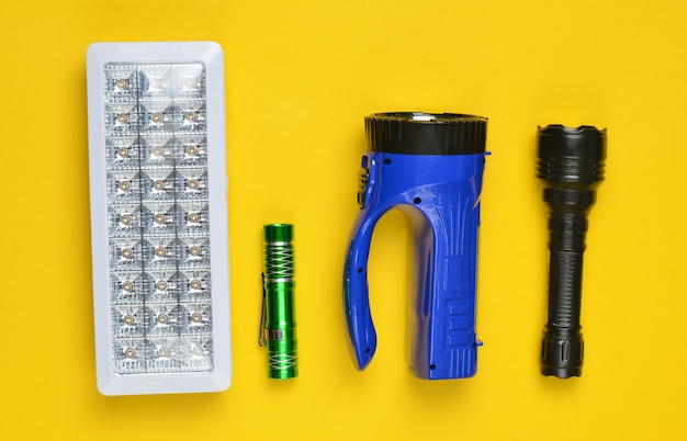Lots of flashlights on a yellow background, top view