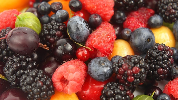 Lots of fresh different berries. healthy fresh vegetables and food