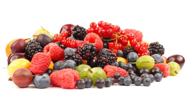 Lots of fresh different berries on a white background. healthy and vitamin food