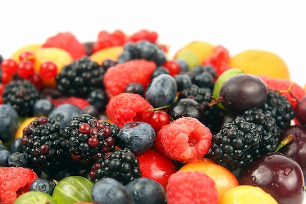 Lots of fresh different berries on a white background