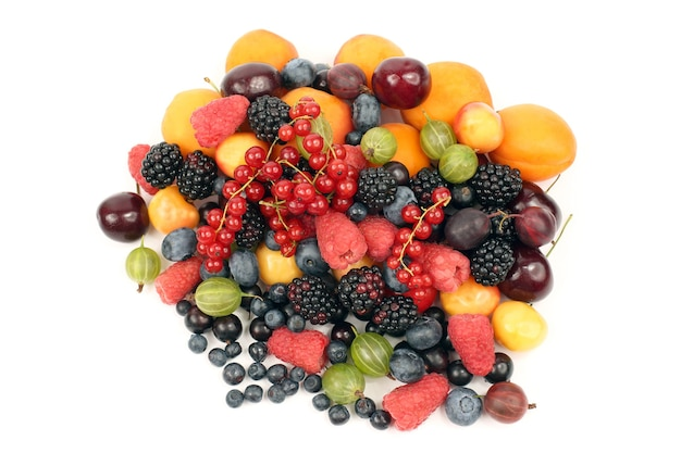 Lots of fresh different berries on a white