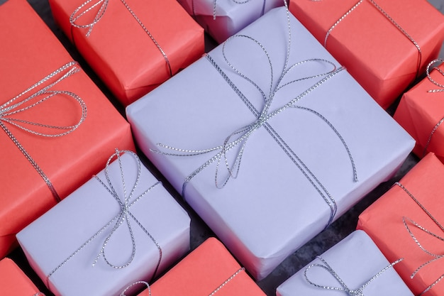 Lots of new year presents wrapped in red and lilac paper