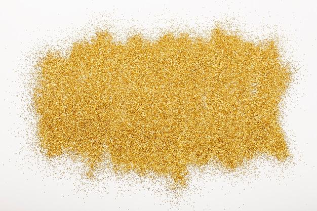 白い背景に光沢のあるゴールドのスパンコールがたくさん。
