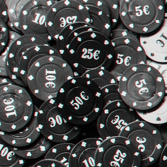 Lots of poker chips with euro icon close-up, top view. black and white photo with glitch effect
