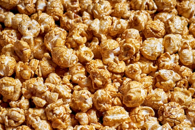 Lots of popcorn with sweet caramel close-up for movies