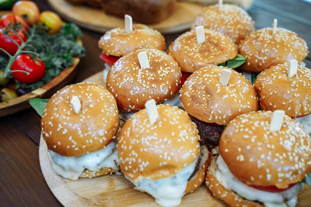 Lots of tasty burgers on the wooden table