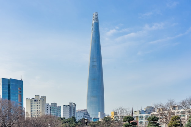 Lotte world tower and cityscape with cloudy blue sky in winter