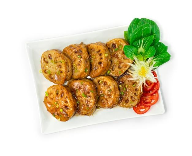 レンコンのぬいぐるみみじん切り豚肉のタレ揚げ日本食風レンコンが野菜の刻みネギを飾る