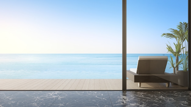 Lounge chair on terrace near living room in modern beach house