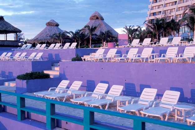 Lounge chairs at beach club, cancun, mexico