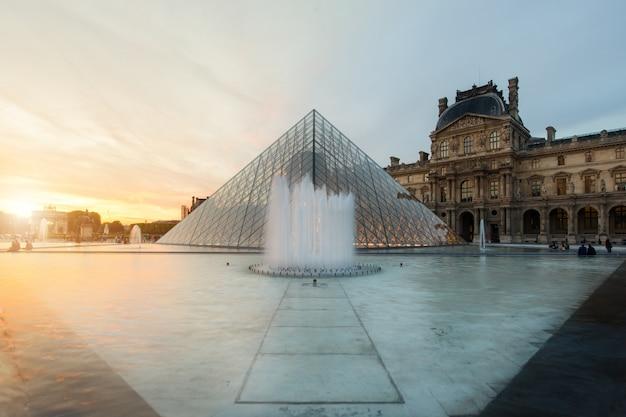Louvre pyramid at louvre museum at paris, france.