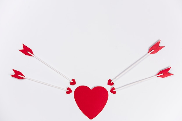 Love arrows aiming at red heart