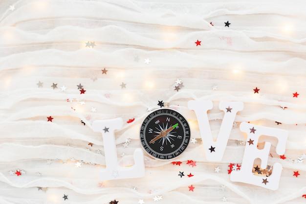 Love background. travel symbol - compass and confetti.