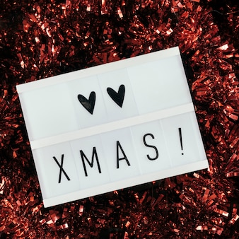 Love christmas text with red tinsel