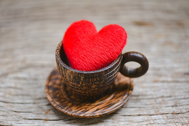 Love coffee concept. heart in wooden coffee cup romantic love valentines day on wood