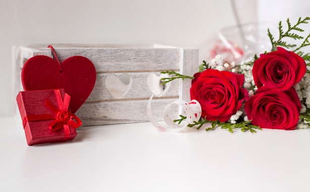 Love composition background with red roses heart and gift and space to write