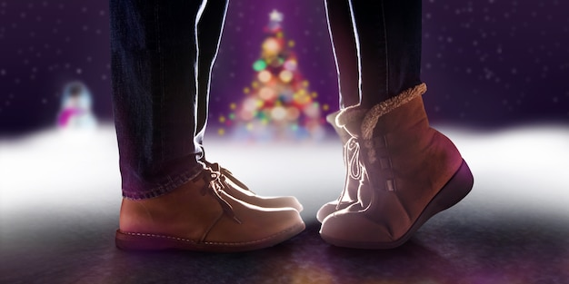 Love concept, low section of couple kissing in romantic christmas night