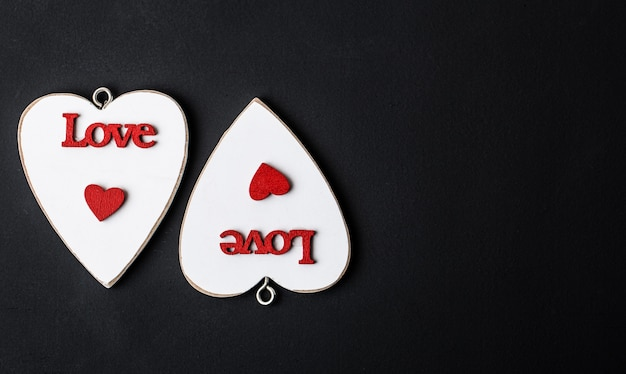 Love concept for mother's day and valentine's day. happy valentine's day hearts on wooden background
