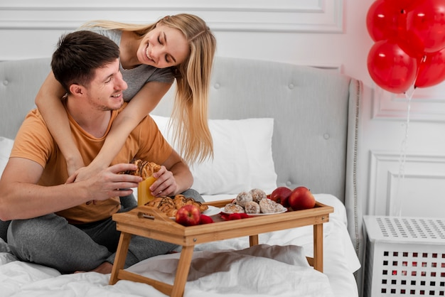 Love concept with breakfast in bed