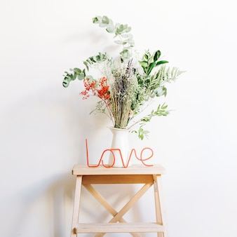 Love concept with plant on stool