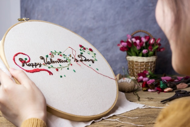 Love concepts of young woman hands are embroidered happy valentines day