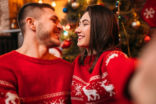 Love couple makes selfie, christmas celebration
